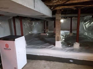 Crawlspace with 20 Mill Vapor Barrier encapsulation and new Dehumidifiert