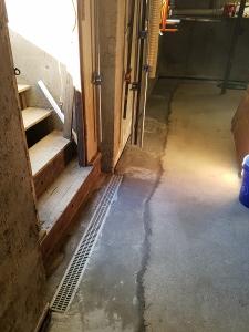 Open trench drain at doorway landing