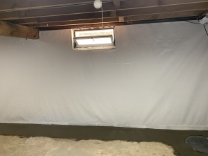 Vapor Barrier on walls for wall seepage. Tied into drainage.