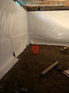 Vapor Barrier installation for moisture control.